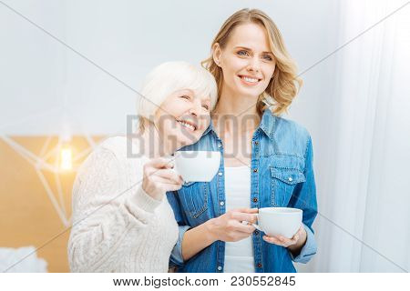 Happy Together. Happy Emotional Senior Woman Leaning Her Head To The Young Kind Granddaughter And Sm