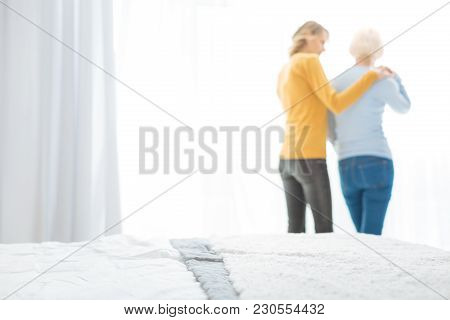 Hug Me. Calm Attentive Young Woman Showing Her Love And Support While Visiting Her Lonely Aged Grann