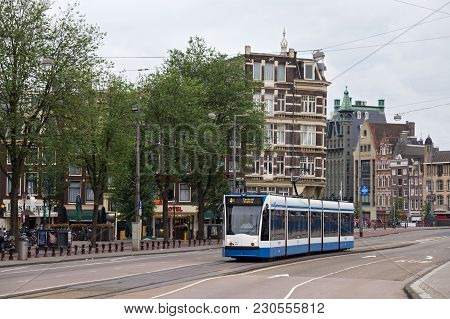 Amsterdam, Netherlands - June 25, 2017: Siemens Combino Tram Passing Through The Centre Of City. The