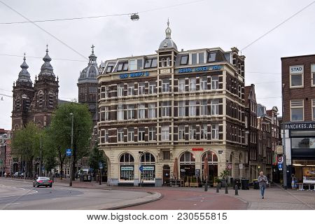 Amsterdam, Netherlands - June 25, 2017: Historical Building On The Prins Hendrikkade Street Near The