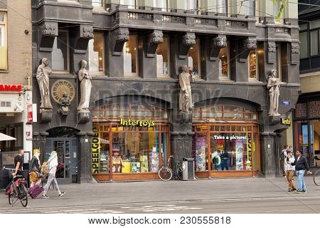 Amsterdam, Netherlands - June 25, 2017: Stone Sculptures On The Wall Of A One Of The Historic Buildi