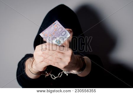 Hands In Handcuffs That Keeps Euro Bills. Bribe. Corruption. Place For Text.