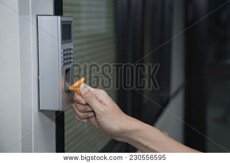 Young Woman Using Rfid Tag Key To Open The Door, Fingerprint And Access Control In A Office Building
