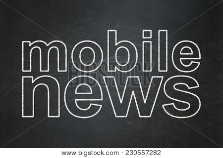 News Concept: Text Mobile News On Black Chalkboard Background