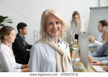 Smiling Female Aged Company Executive Or Team Leader Looking At Camera, Happy Senior Businesswoman T