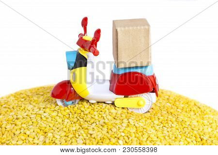 Colorful Motorcycle With Delivery Boxes And A Lot Of Yellow Split Mung Dal Or Moong Dal Pile On The