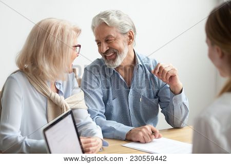 Happy Senior Family Talking Smiling At Meeting With Financial Advisor, Older Clients Ready To Buy Me