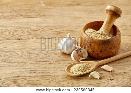 Beautiful Kitchen Still Life Wooden Mortar Full Of Grind Spicies And Pestle With Ginger And Flat Coo