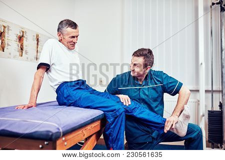 Senior Man On A Physiotherapy Session A Hospital