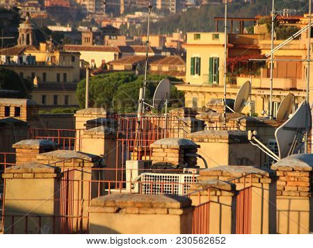 Satellite Dish And Antenna On Urban Roof Background