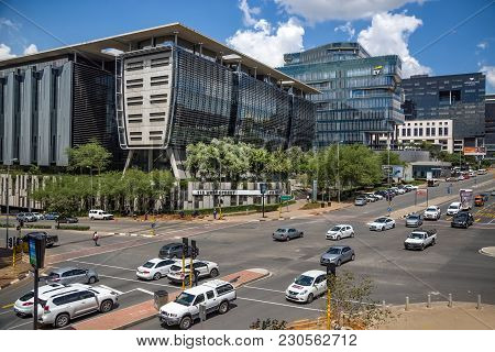 Johannesburg, South Africa - March 8, 2018: Cars Passing Through Traffic Intersection In City Center