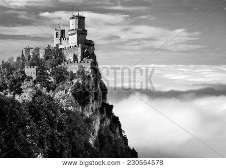 Rocca Della Guaita, The Most Ancient Fortress Of San Marino, Italy. The Fog At The Bottom Creates Th