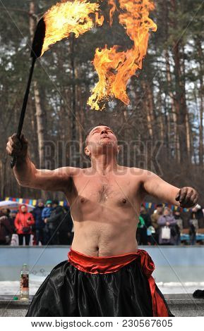 Cherkasy, Ukraine - February 25: Unidentified Male ( Fakir,master) Demonstrate Fire-breathing ,stree