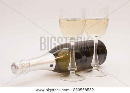Champagne Bottle And Champagne Glasses On White