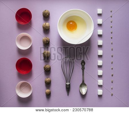 On A Lilac Background Fod Knoling Walnut Greek Seeds Sunflower Sugar Cube Refined Corn Spoon Egg In