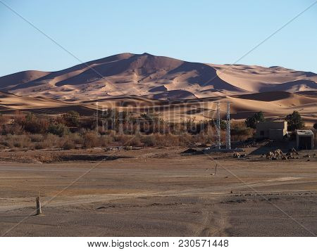 Erg Chebbi Dunes Range Near Merzouga City With Landscapes Of Sandy Desert Formations In Southeastern
