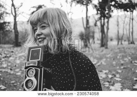 Beautiful Young Woman With Vintage Style Clothes And Camera