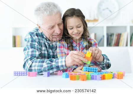 Portrait Of Grandfather Playing With Her Little Granddaughter