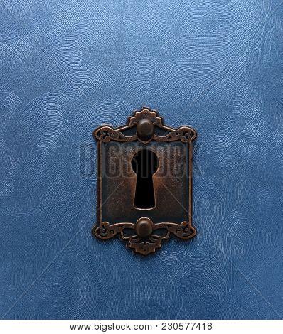 A Vintage Lock On Blue Textured Metal