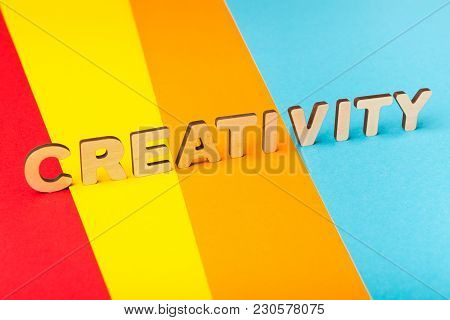 Word Creativity Made Of Wooden Letters On Colorful Background. New Idea, Innovation, Be Brave And De