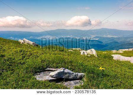 Grassy Meadow With Boulders On Hillside. Beautiful Landscape On Fresh Summer Morning