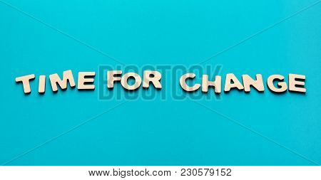 Motivation Poster. Phrase Time For Change Spelled With Wooden Letters On Blue Background. Motivation