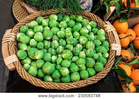Fresh Raw Brussels Sprouts In A Basket On Organic Farmer's Market