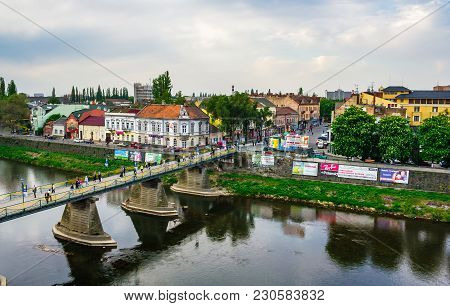 Uzhgorod, Ukraine - April 29, 2011: Bird Eye View Of Uzhgorod Town. Pedestrian Bridge And Old Archit