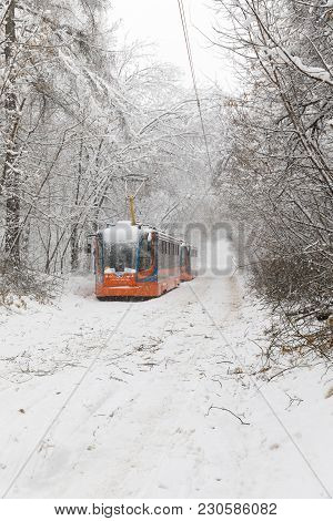 Heavy Snowfall In Moscow. Snow-covered Roads And Damaged Power Lines During A Snowfall. Collapse Of