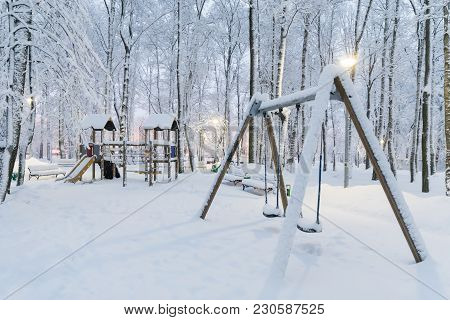 Heavy Snowfall In Moscow, Children's Playground Under The Snow. Collapse Of Public Services