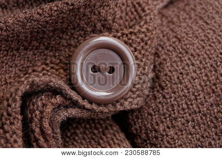 Large Brown Button On A Piece Of Woolen Clothes
