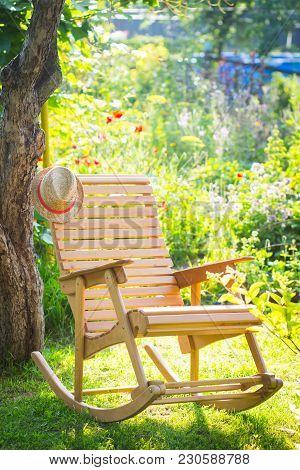 Rocking Chair In A Sunny Green Garden