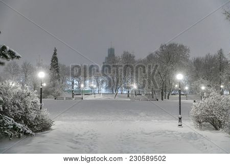 Heavy Snowfall In Moscow. Night View Of Parks And Avenues During A Snowfall. Collapse Of Public Serv