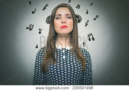 Wistful Young Girl Listening Music Via Drawn Headphones With Many Notes Around Her Head Isolated On