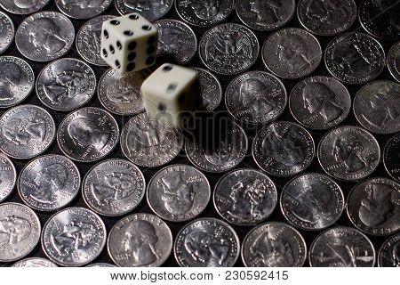 Blurry Dice Rolled Over Silver Us Currency Quarters In A Uniform Pattern 2