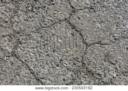 Old Worn And Cracked Asphalt With Cracks