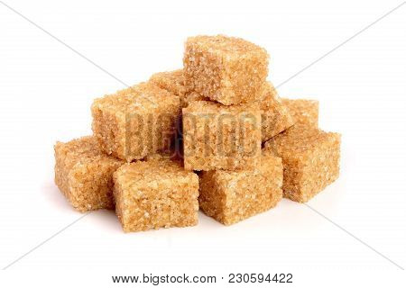 Brown Sugar Cubes Isolated On White Background.