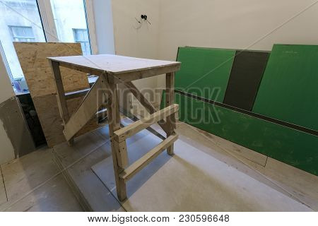 Wooden Board In Room, Sheets Of Plasterboard Or Drywall And Garbage In The Bags Are An Apartment Dur