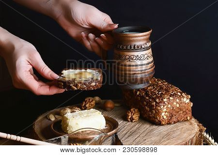 Dark Cereal Bread With Sunflower Seeds With Butter, Cup Of Milk In Hands, Butter And Honey, Concept
