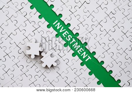 Investment. The Green Path Is Laid On The Platform Of A White Folded Jigsaw Puzzle. The Missing Elem