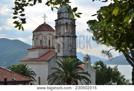 Old Monastery Surrounded With Trees In A Summer Landscape