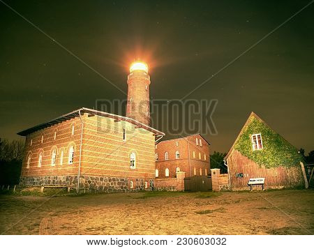 Lighthouse Searchlight Beam Through Dark Night.  Lighthouse At Darsser Ort Near Prerow, Baltic Sea,