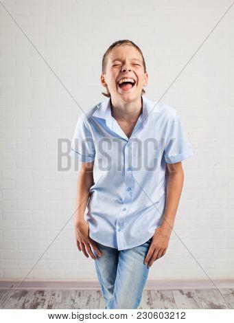 Happy boy. Smiling teenager at school