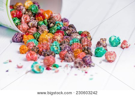 Brightly Colored Candied Popcorn, White Background. Horizontal Image Of Junk Food, Fruit Flavored Po