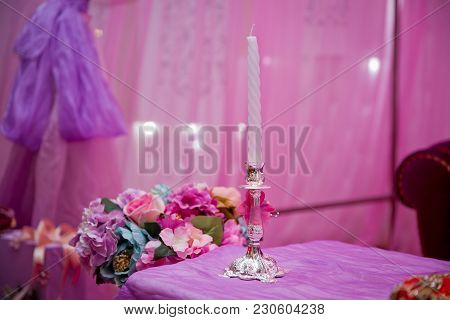 Beautiful Candle On Pink Background . Candle In Candlestick Burning . Retro Candelabra With Burning