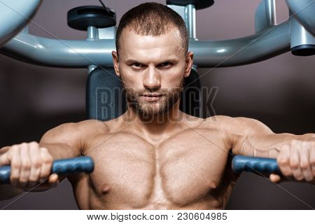 Portrait Of Young Muscular Sporty Man Doing Pulling-up