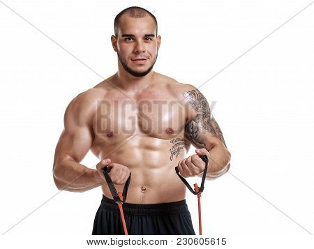 Sporty Muscular Naked Man Exercising With Elastic Expander