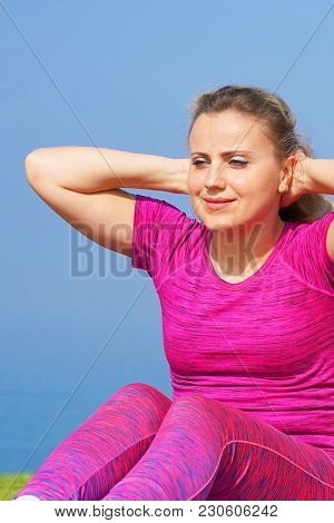 Young Woman Abdominal Exercise On Sea Beach To Keep Fit And Health. Doing Crunches Core, Leg Raising