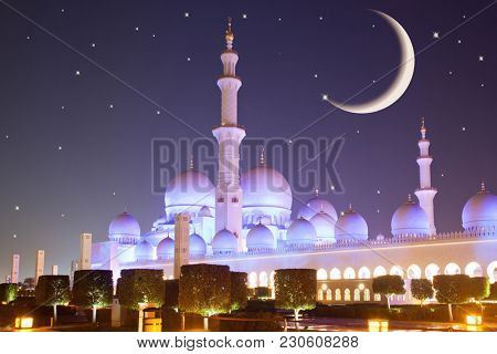 eid mubarak postcard with crescent moon and Sheikh Zayed grand mosque in the background at night, Abu Dhabi, UAE