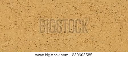 Textured Yellow Plaster Wall Background. Structural Venetian Wall Finish Covering Background. Walled